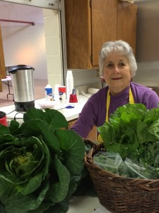 ShepherdsMarket_volunteerwithproduce